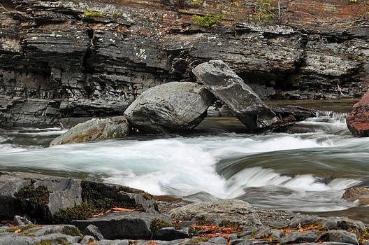 Boulders in McDonald Creek by Bruce Gourley