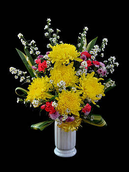 Bouquet of flower in vase isolated on black by Somkiet Chanumporn