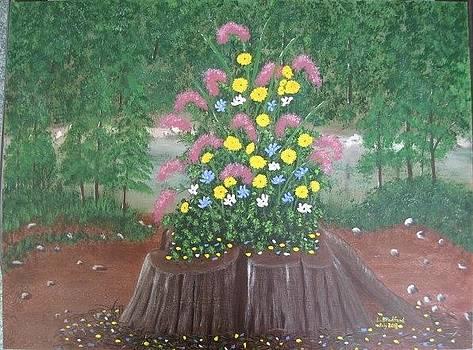 Bouquet on a stump by Lorraine Bradford