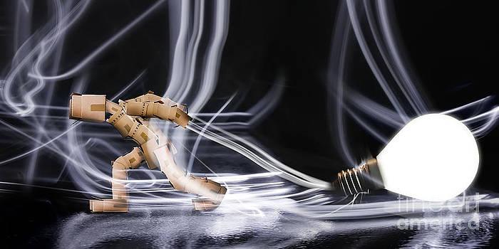 Simon Bratt Photography LRPS - Box man dragging a light bulb