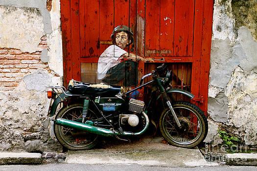 Boy on a Bike by Donald Chen