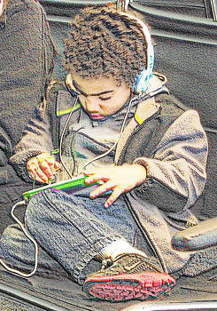 Boy Passing Time at Airport by Bobby Miranda