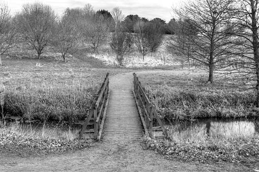 Fizzy Image - bridge over river in an english countryside scene on a stormy da