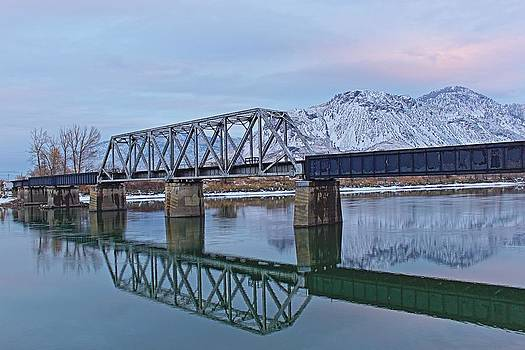 Bridge Over Tranquil Waters in Kamloops British Columbia by Steve Boyko