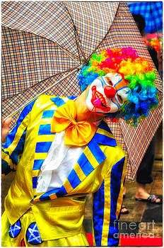 David Hill - Brightly dressed clown with umbrella