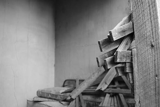 Broken boards in an abandoned home by Amanda Letcavage