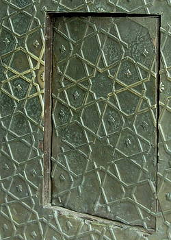 Bronze door in a door by Russell Smidt