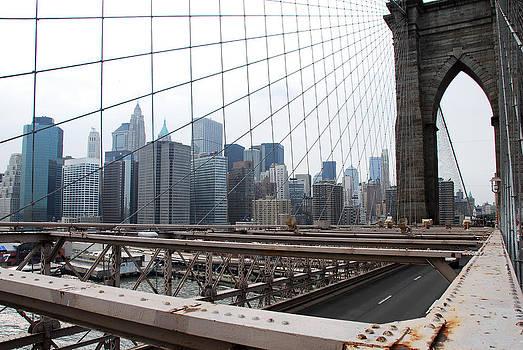 Brooklyn Bridge and Manhattan Skyline in New York by Bhupendra Singh