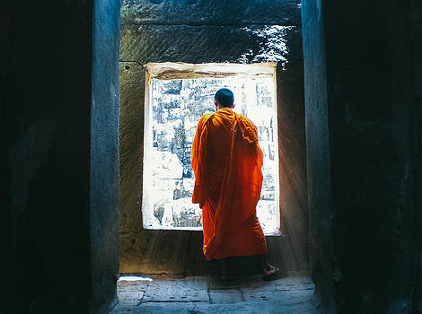 Buddhist monk in bayon temple angkor wat by Leander Nardin