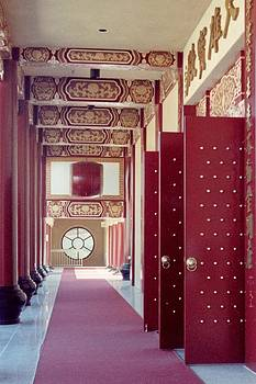 Buddhist Temple Hallway by Maggie  Cabral