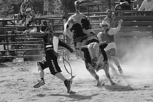Bullfighters vs Bull by Rod Andress