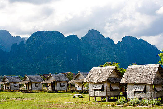 Bungalows in Vang Vieng Laos by Christy Woodrow