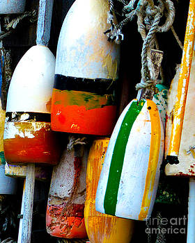 Buoys on a Wall in Rock Harbor Cape Cod by Phil Hawn