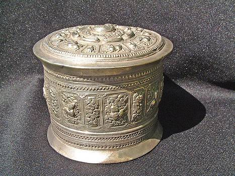 Burmese silver container with high relief chiseled decorations by Burmese silversmith