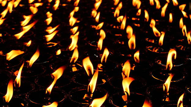 Butter lamps in Bodhgaya by Greg Holden