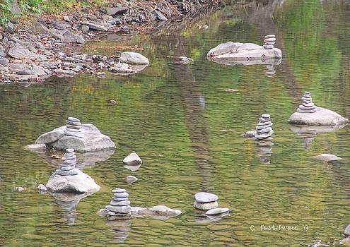 Cairns stacked in the Water by Carolyn Postelwait