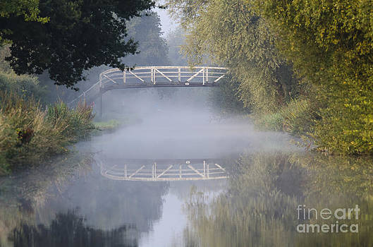 Canal bridge in the mist  by Steev Stamford