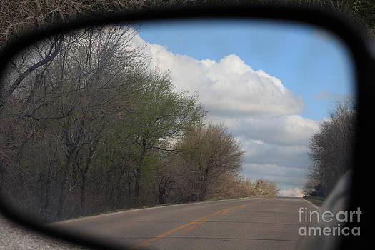 Car Mirror Landscape with road and sky. by Robert D  Brozek