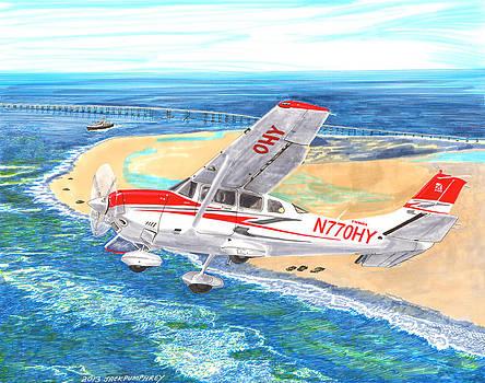 Jack Pumphrey - Cessna 206 flying over the outer banks