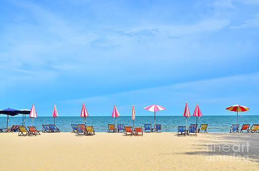 Chairs and umbellar on white sand beach. by Keerati Preechanugoon