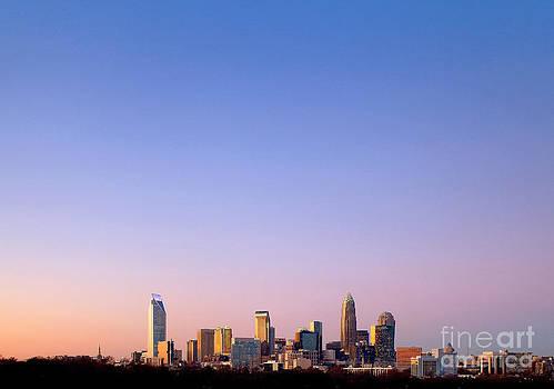 Charlotte skyline in distance by Patrick Schneider
