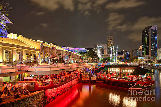 Chasing the light at Clarke Quay by Pete Reynolds