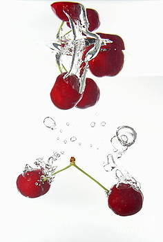 Cherries fruits splashing underwater by Sami Sarkis