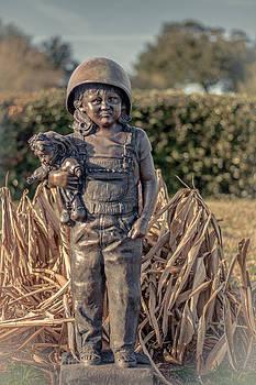 Child holding Doll by Jon Cody