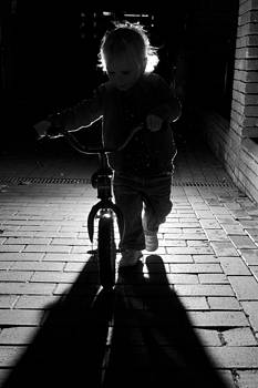 Child with bike by David Isaacson