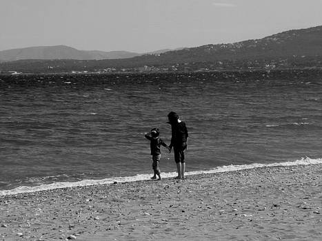 Children at the Sea shore by Angela Zafiris