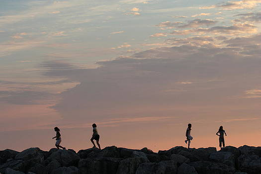 Children Paying At Sunset Time by Carolyn Reinhart