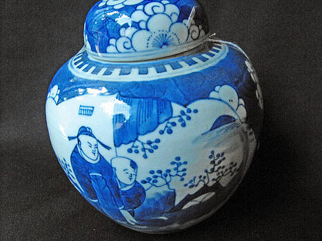 Chinese blue and white ginger jar with 2 panels featuring a figural design by Chinese ceramic artist