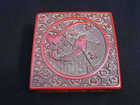 Chinese cinnabar lacquer box decorated with a bird and blooming prunus by Anonymous artist