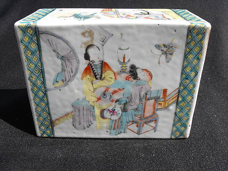 Chinese porcelain pillow with figural design by Master Chinese ceramic artist
