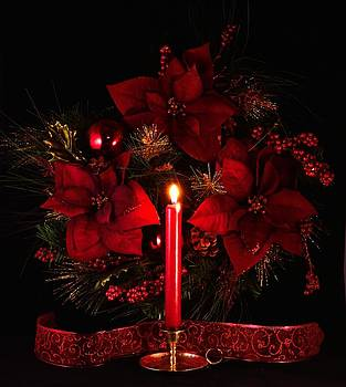 Christmas candle by Glenn Sanborn