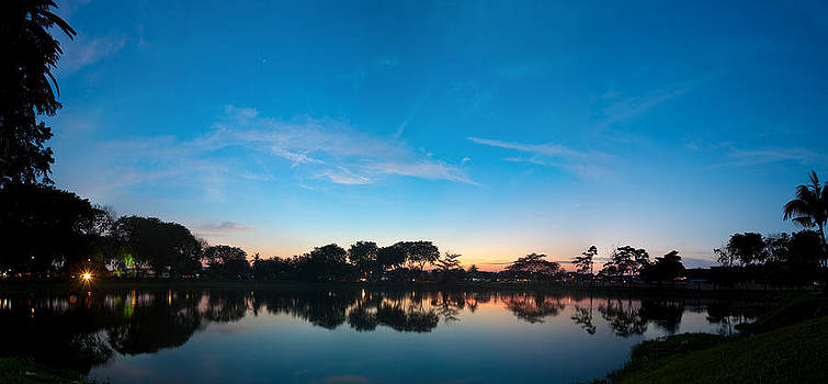 Clear blue sky at dusk hour near a lake side panorama by Calvin Chan