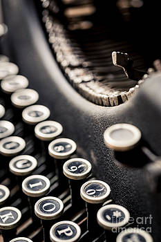 Close-up of an Old Typewriter with a Raised Striker by Brycia James