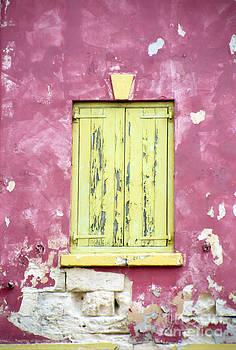 Oscar Gutierrez - Closed Yellow Shutters on an Abandoned Building