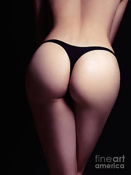 Closeup of sexy woman butt in black thongs by Oleksiy Maksymenko