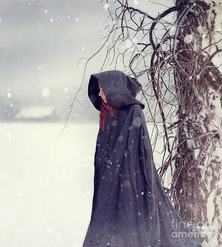 Sandra Cunningham - Closeup of woman in cape walking in snow