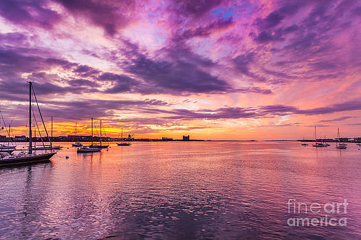 Clouds and vivid sunrise colors over Boston Harbor by Jo Ann Snover