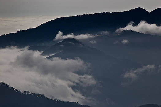 Clouds over the mounatins by Brian Magnier