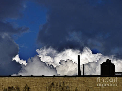 Clouds Over The Watertower by Mark Thomas