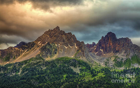 Cloudy Sunset Over the Peaks by Radu Razvan