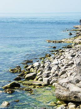 Coastal Rocks at The Edge of The Sea by Moya Moon