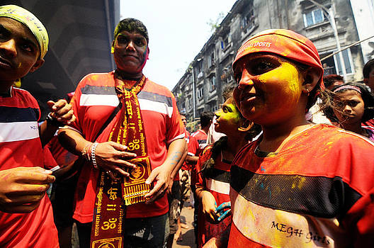 Colored Faces in procession by Money Sharma