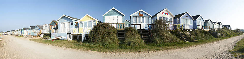 Colourful Beach Huts in Dorset by Adrian Brockwell