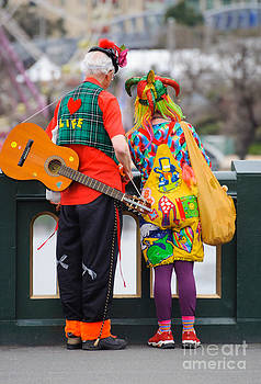 David Hill - Colourfully dressed buskers pause on the way home