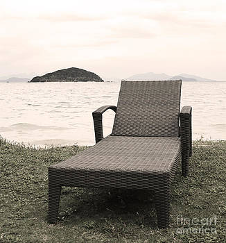 Couch on Mark Island Beach by Pakorn Kitpaiboolwat