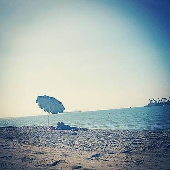 Couple Underneath An Umbrella #longbeach by Zarah Delrosario